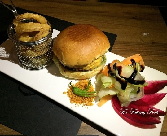 #NewOnTheBlog One of my favourite restaurants in Delhi open their second outlet in GK 1 N Block. @depot48 is hereeee!   This is a Vada Pav Burger, for those who like the quintessential vegetarian stuff and don't have non veg, this is a must order for you. You'd think an American place won't get a Vada Pav Burger right, but that's where you go wrong. A thin coating on the vada, delicious stuffing inside (very authentic), a soft bun that's very similar to a pav, served with crisp golden onion rings and salad. Read the blog to know why Depot48 is a winner all the way.
