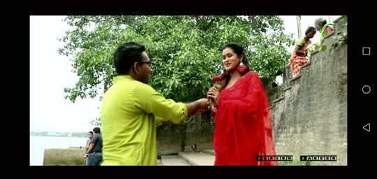 Green kurta guy offering flower to red saree lady.. No political pun intended in my music video https://www.youtube.com/watch?v=psTM3Xo7daM https://youtu.be/Arla-cE_3LE